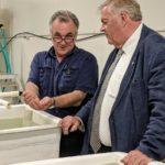 governor observes man handling small marine species