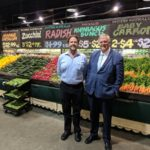 governor with man in front of fruit and vegetables
