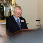 man reads at lectern