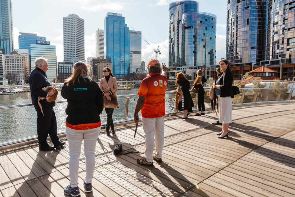 The Governor and Ms Annus standing with staff and guides on Elizabeth Quay suspension bridge
