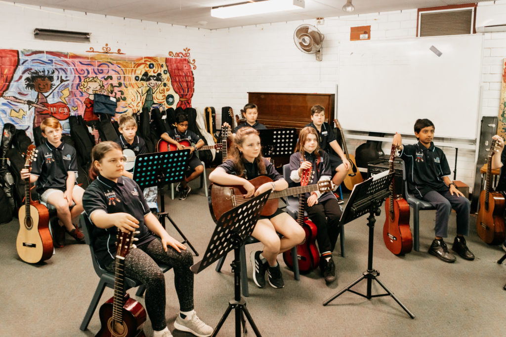 students in classroom with instruments