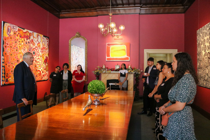 The Governor showing the graduates of the WAALI Emerging Leaders Program the Aboriginal Art throughout Government House