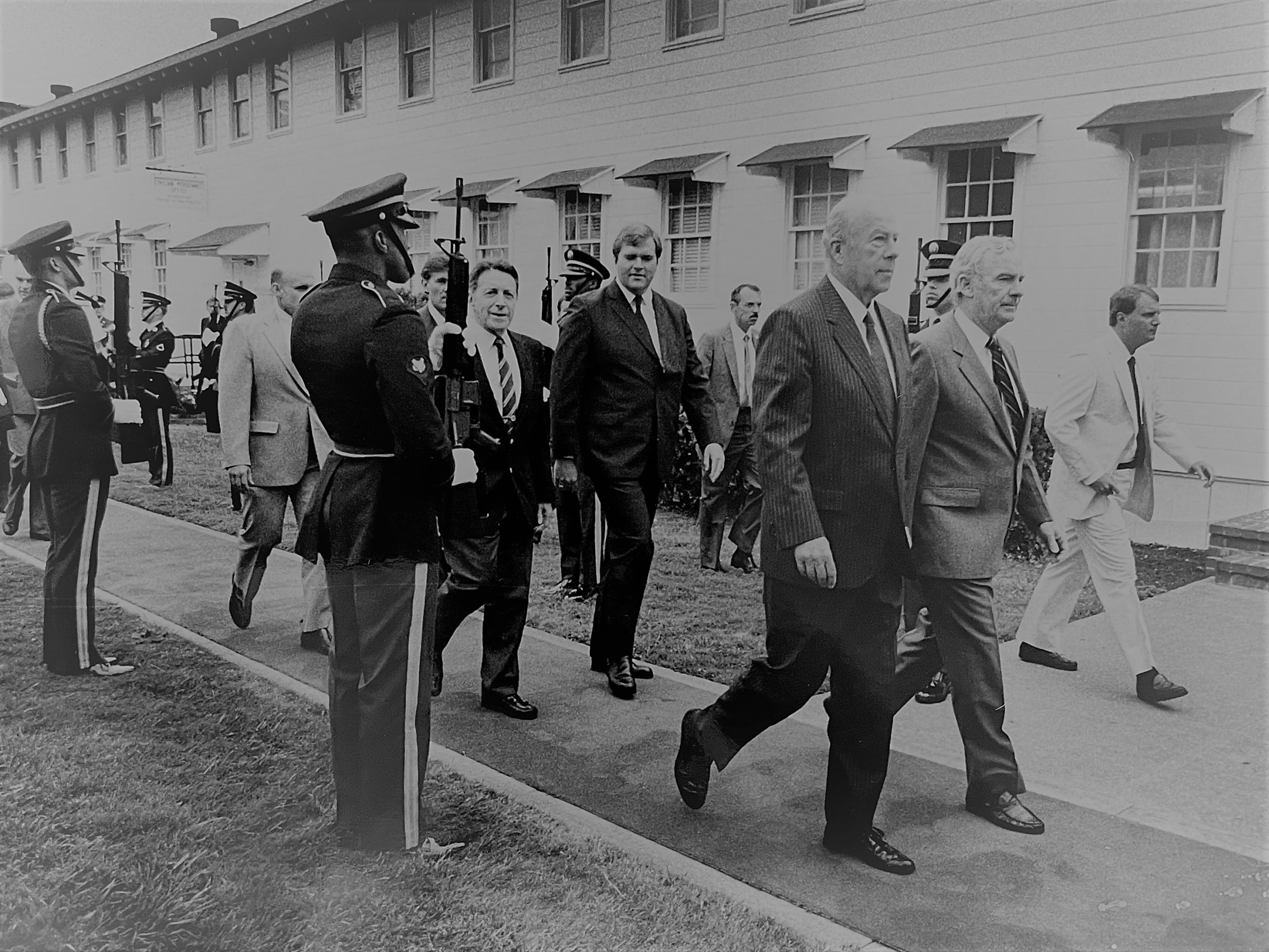 Governor walking with George Shultz